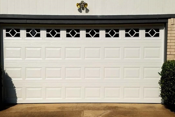 white 16x7 garage door with windows and inserts